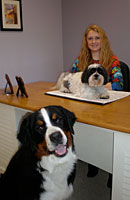 Heather in office with two dogs