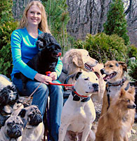 Heather with large outdoor group of dogs